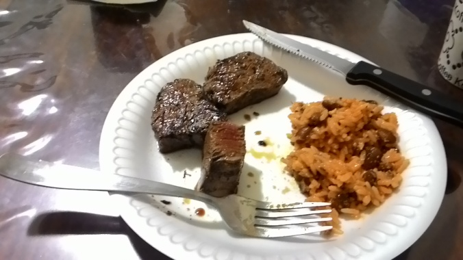 Cheap lunch at home, 12 oz of Filet Mignon and Spanish rice,about $3.00 US