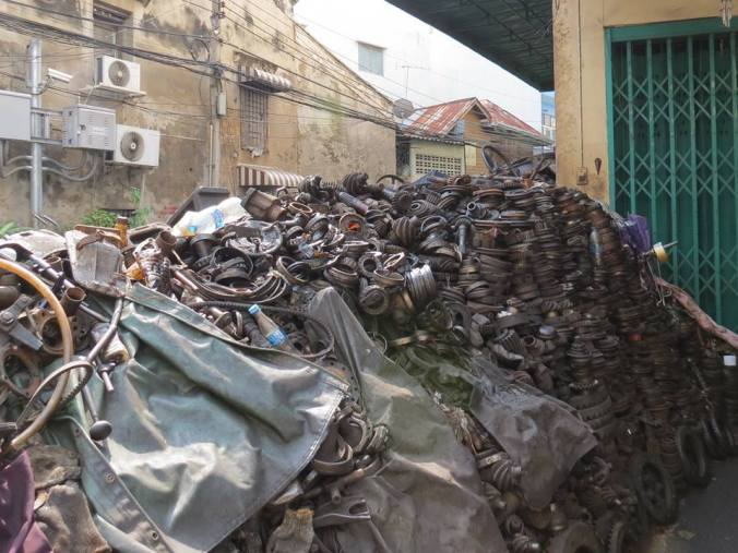 Creepy alley with tons of old auto parts in Bangkok Chinatown.