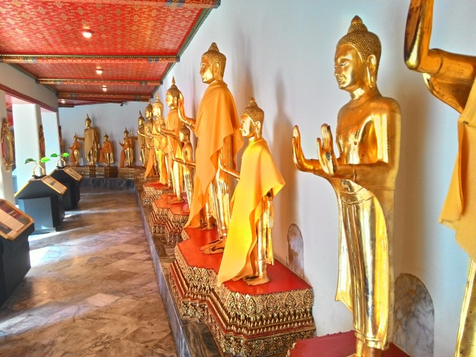 a collection of Theravada Buddhas in a shrine at Wat Pho.