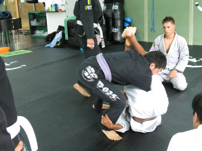 "Professor Bruninho shows the details of the ""corkscrew"" armbar!"