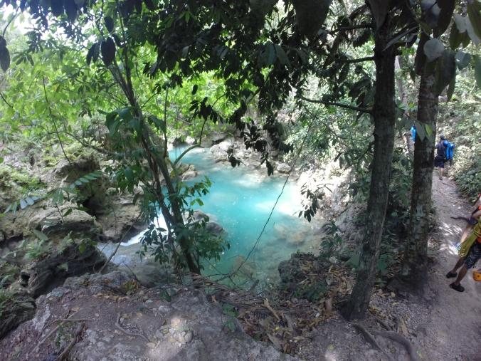 The view of the beautiful blue water of Kawasan Falls canyon.