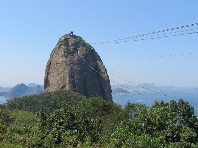 "Pao de Acucar is named after the shae of old ""sugar loaves"" made by drying pressed sugar cane in pointy barrels or pots."